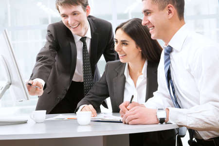 Happy young business people working together photo