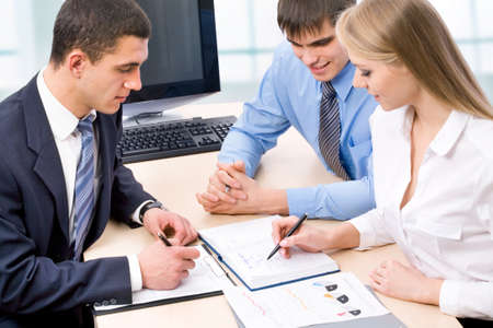 focus group: Young business people are working in the meeting room. Stock Photo