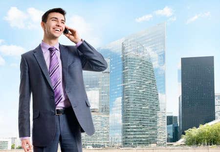 Young businessman against a background of modern skyscrapers Zdjęcie Seryjne