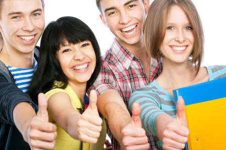 Group of happy students giving the thumbs-up sign photo