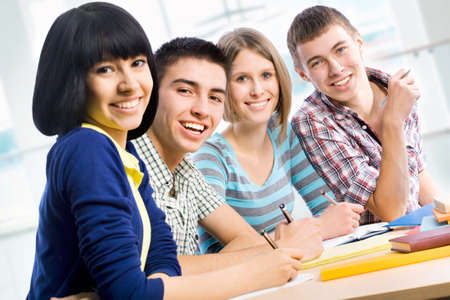 college classroom: Portrait of a happy students Stock Photo