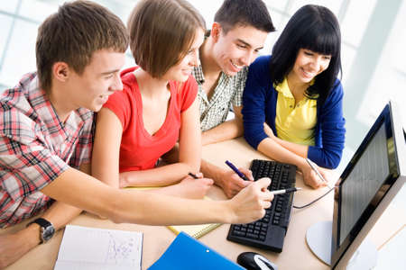 Young students studying together in a classroom photo
