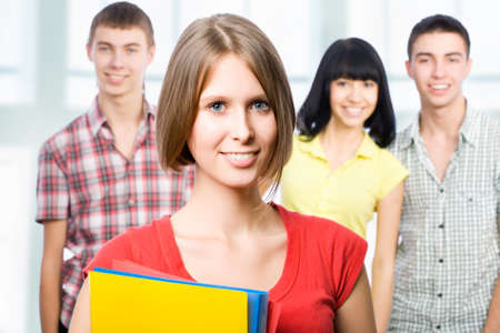 Cheerful girl student and her friends photo