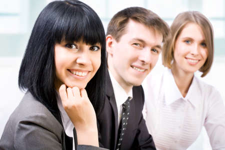 corporate responsibility: Young businesswoman and her team, Stock Photo