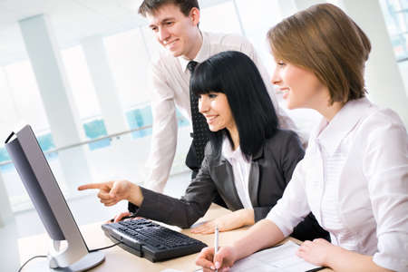 discussing: Young business people are working in the meeting room. Stock Photo