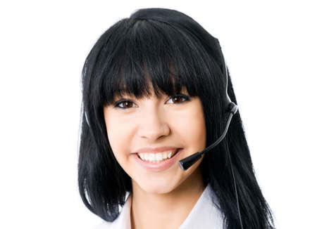 Headset. Customer service operator woman with headset smiling looking at camera. Isolated on white background.  photo