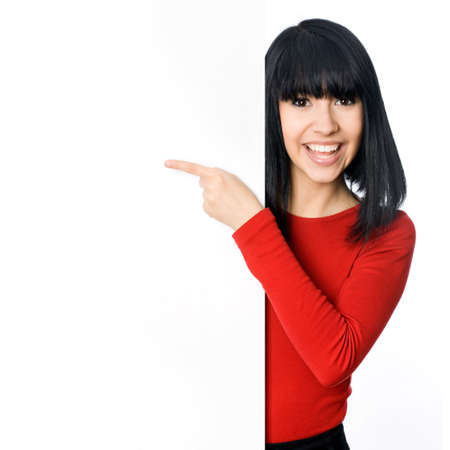 woman pointing: Happy asian girl pointing at a blank board