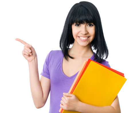 woman pointing up: Asian girl student shows up on white background