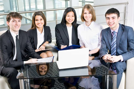 Group of happy multi ethnic business people in a meeting at office Stock Photo - 13854482