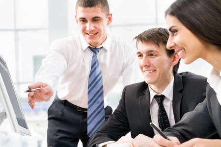 teach: Image of successful partners discussing business plan at meeting