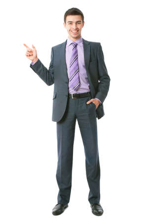 businessman standing: Attractive business man pointing at copyspace