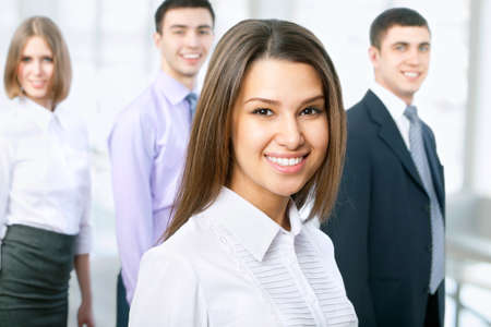 Portrait of female leader with cheerful team in background Stock Photo - 13854551