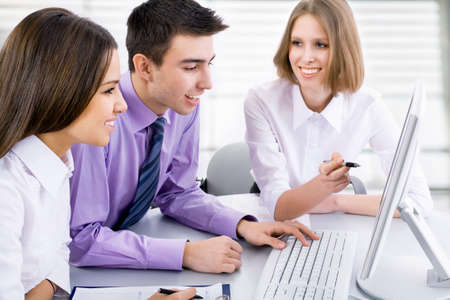 studing: Young business people are working in the meeting room. Stock Photo
