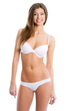 badpak: Portret van een prachtige jonge vrouw poseren in bikini op een witte achtergrond