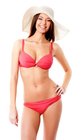 attitude girl: Beautiful woman in bikini and hat smiling on a white background
