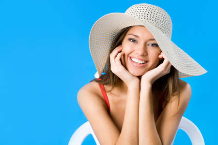 Beautiful woman with hat smiling on a background of blue sky Stock Photo - 14735048