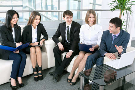fun at work: Group of business people analyzing and discussing during a working meeting in a modern office  Stock Photo
