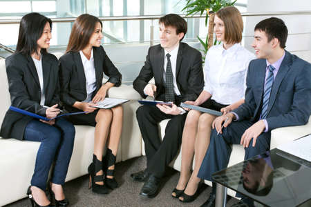 Young business people working in the office photo