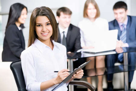 studing: Young business woman and her team Stock Photo