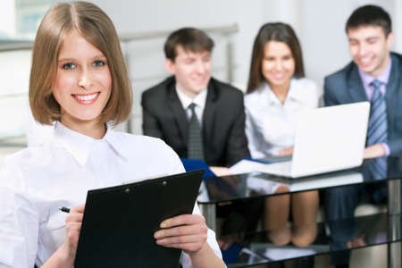 Portrait of a smiling young attractive business woman in a meeting   Stock Photo - 14735063