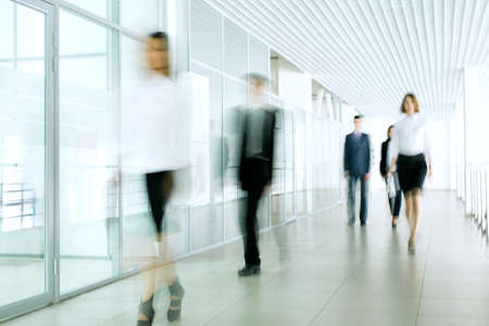 corridors: Business people walking in the office corridor   Stock Photo