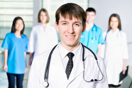 Doctor standing in Front of her team in the hospital  photo