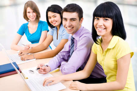 Happy group of young students studying together in a college Stock Photo - 14735106