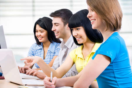 studygroup: Young students studying together in a classroom
