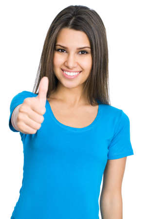 thumbs up woman: Happy female college student showing thumbs up Stock Photo