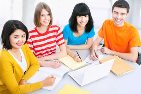 Young students studying together in a classroom Stock Photo - 14735210