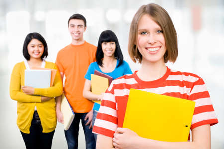 studygroup: Group of happy young teenager students standing and smiling