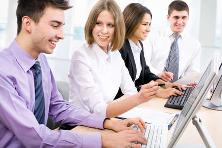 Group of happy multi ethnic business people in a meeting at office Stock Photo - 14735132