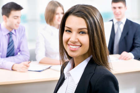 Young business woman and her team Stock Photo - 14735065