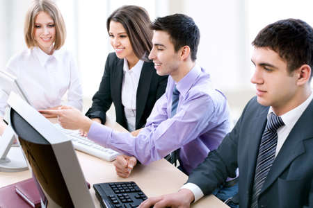 Business partners working at a computers in the office Stock Photo - 14735160