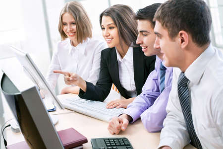 Business team working at a computers in the office Stock Photo - 14735157