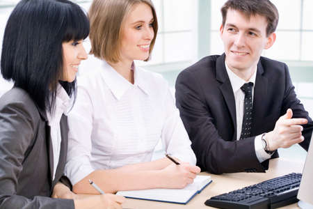 Boardroom meeting: Teamwork - Business man showing something on computer screen to colleagues