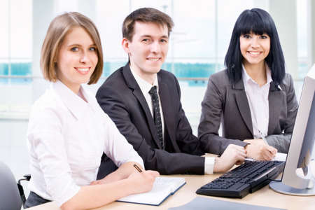 Business partners working at a computers in the office Stock Photo - 14735091
