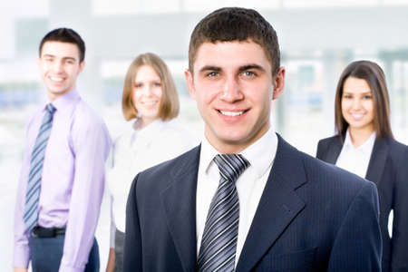 Portrait of young businessman with cheerful team in background Stock Photo - 14735172