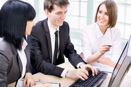 Business partners working at a computers in the office Stock Photo - 14735184