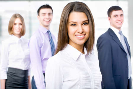 Entrepreneurs: Young business woman and her team Stock Photo