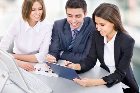 Teamwork - Business man showing something on computer screen to colleagues Stock Photo - 14735176