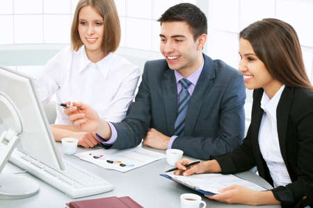 Business people working at a computers in the office Stock Photo