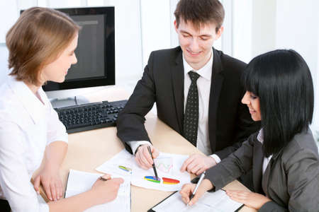 Group of happy business people in a meeting at office Stock Photo - 14735161