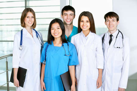 Portrait of a successful medical team at work in hospital  photo