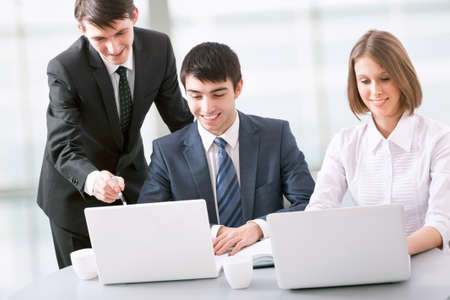 Group of happy business people in a meeting at office photo