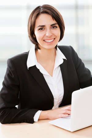 outwork: Business woman working on laptop computer at office