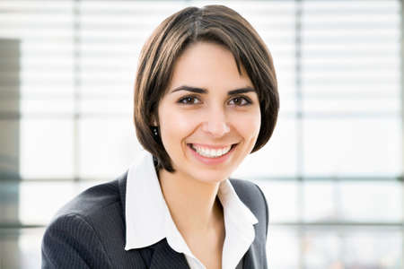 Closeup portrait of cute young business woman smiling