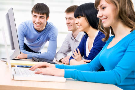 studygroup: Young students studying together with computers