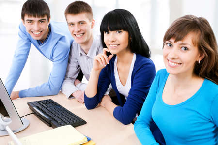 studing: Group of smiling students looking at camera