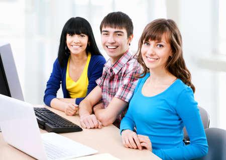 studygroup: Young students looking at camera and smiling